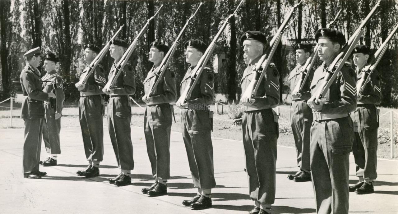 Major General L H Howard-Jones, CBE inspecting the Quarter Guard at REME Workshop, Berlin