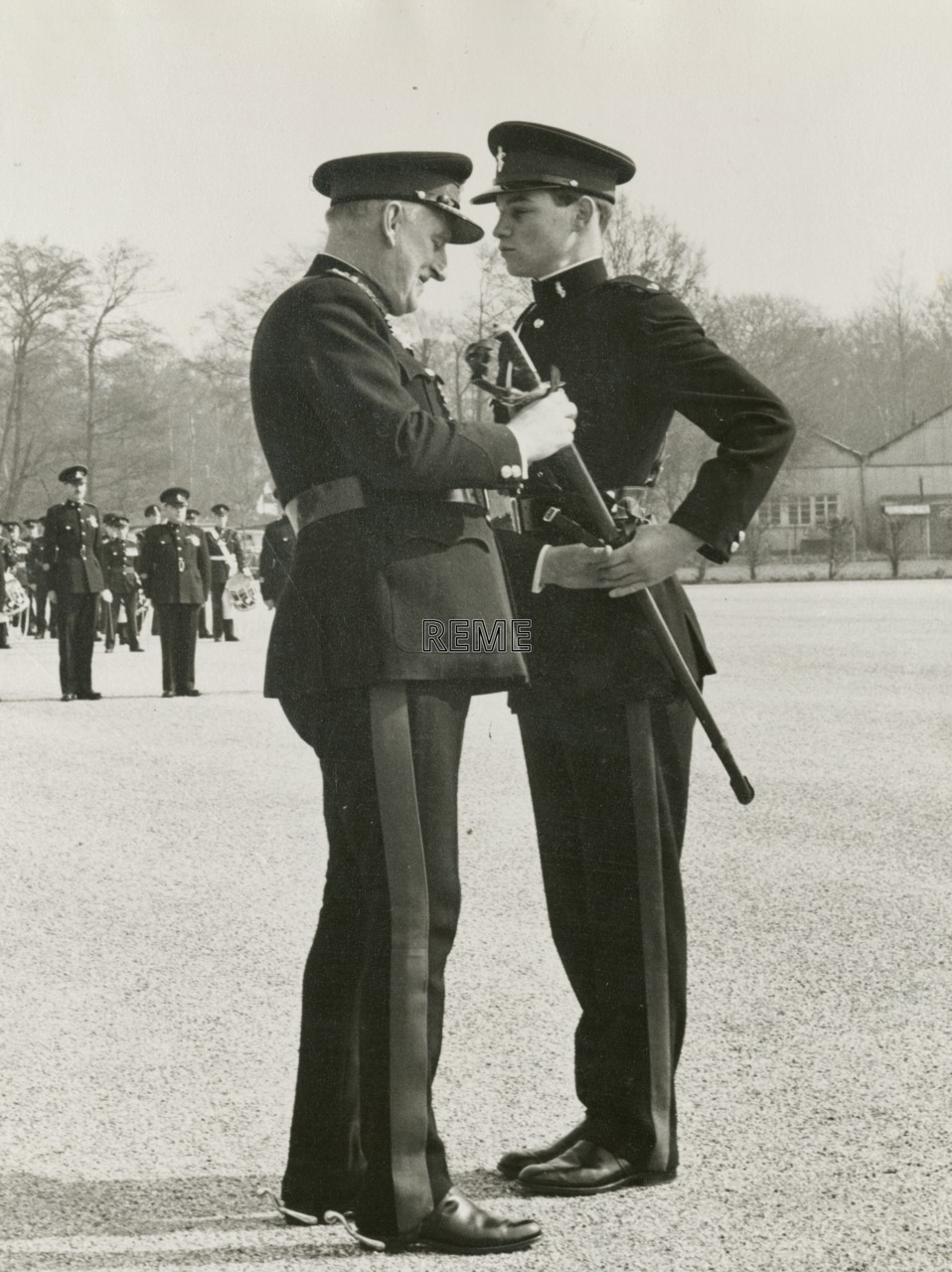 'A Unique Corps Occasion': Major General Lord, CB, CBE presents his sword to his son, May 1960.