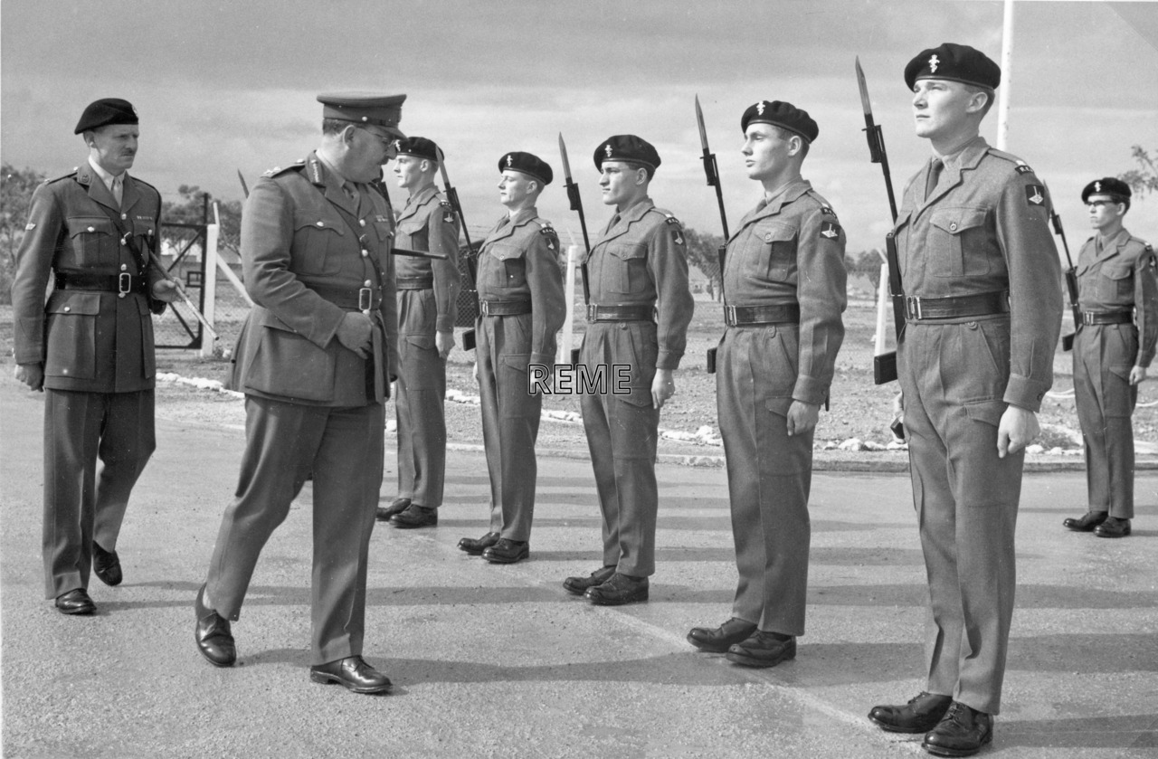 Major General D A K Redman, CB, OBE, inspecting Quarter Guard of 2 Royal Tank Regiment Light Aid Detachment (LAD) REME, North Africa, 24 January 1962.