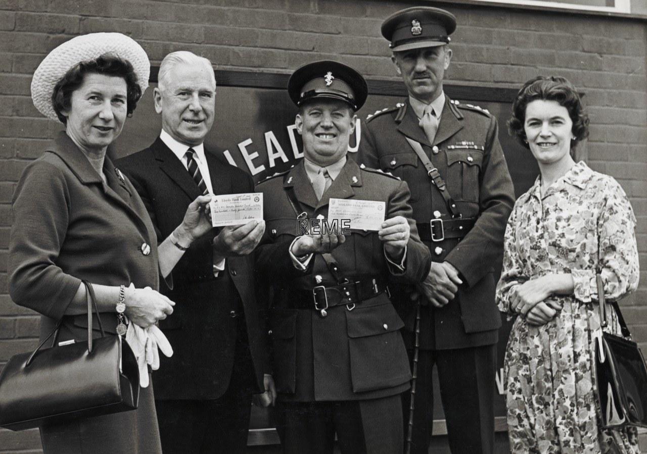 Presentation of cheques to the Army Benevolent Fund at Bordon.