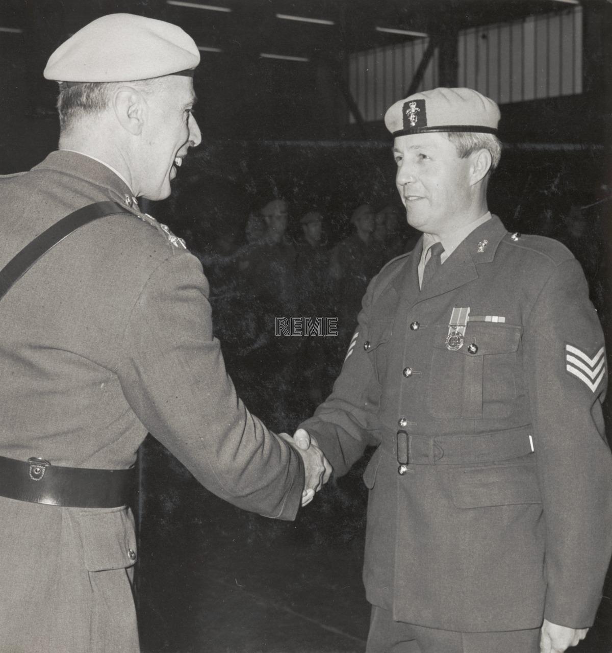 Sergeant B Bane receives the British Empire Medal (BEM)