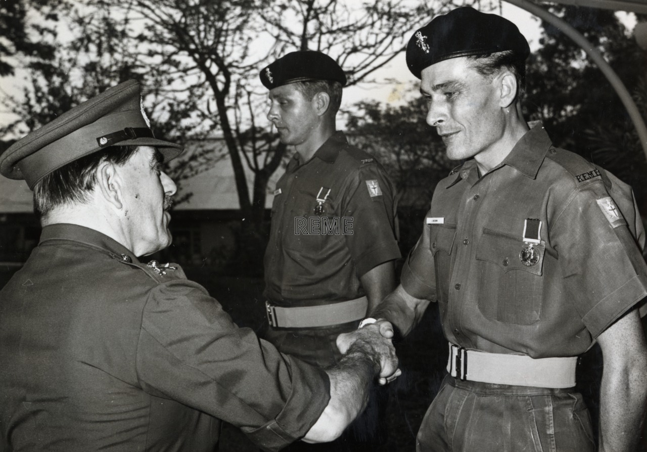 Artificer Quarter Master Sergeant (AQMS) Brown receiving the Long Service and Good Conduct Medal